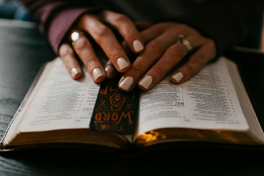 woman at table with her Bible laid open