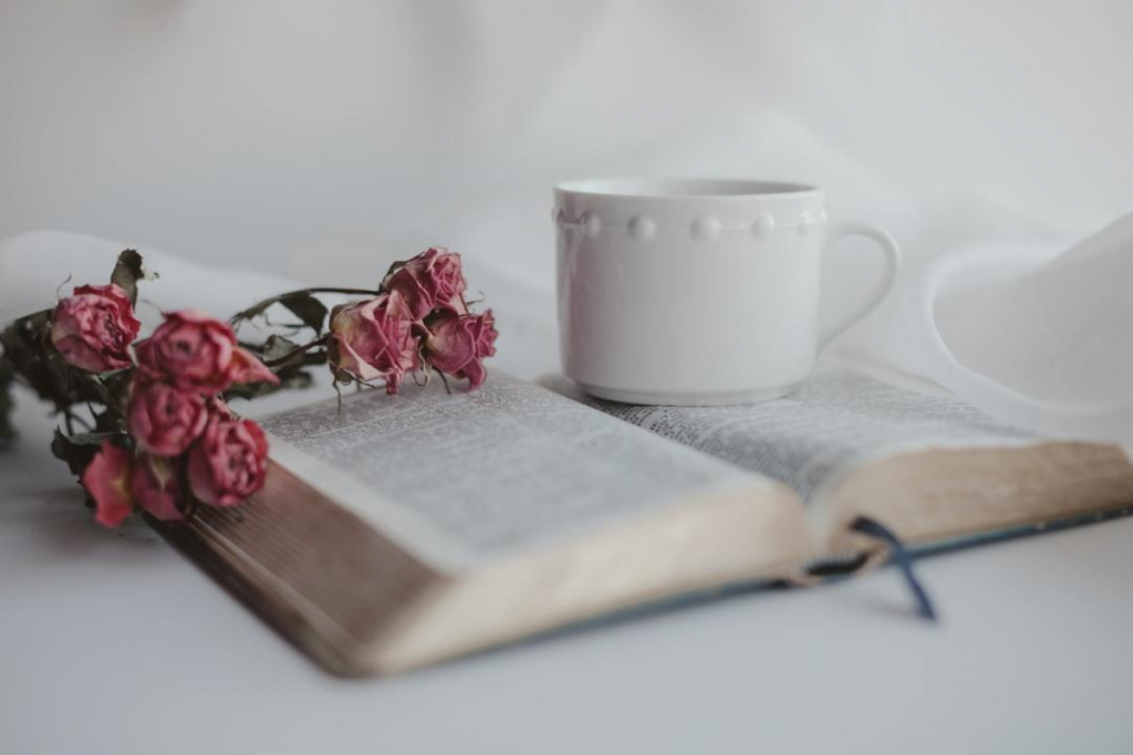 bible open with a flower and coffee